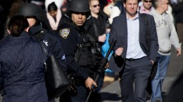 A New York City police officer patrols Times Square in New York, New York, USA, on 20 November 2015. EPA, JUSTIN LANE