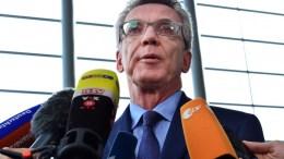 German Interior Minister Thomas de Maiziere speaks to journalists. EPA/MARTIN SCHUTT