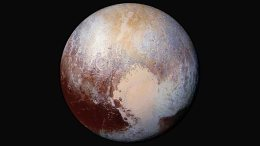 A handout image provided by NASA shows the dwarf planet Pluto in enhanced color. New Horizons scientists used enhanced color images to detect differences in the composition and texture of Pluto's surface. NASA/JHUAPL/SwRI HANDOUT EDITORIAL USE ONLY