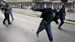 A supporter of the Kosovo opposition political parties throws rocks during a violent protest in Pristina, Kosovo 18 November 2015. Kosovo Police used tear gas to disperse opposition supporters gathered to protest the arrest of a lawmaker of the opposition. EPA/VALDRIN XHEMAJ