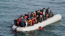 FILE PHOTO. Refugees and migrants arrive in an overloaded rubber dinghy on the Greek island of Lesvos, Greece. EPA, STRINGER