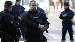Police officers in Paris, France. EPA, IAN LANGSDON