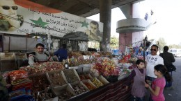 FILE PHOTO: People walk at a market after a ceasefire that went into effect in the capital Damascus, Syria, 27 February 2016. According to monitoring group, the ceasefire in Syria was largely holding on 27 February hours after the deal brokered by Russia and the United States went into effect. The Syrian government and 97 rebel and militant groups have agreed on the truce that went into effect at midnight 26 February (2200 GMT) without including the Islamic State militant group or the al-Nusra Front, an al-Qaida affiliate in Syria. EPA, YOUSSEF BADAWI