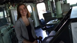 FILE PHOTO: Deputy Assistant Secretary of State Dr. Amanda Sloat takes the helm of the guided missile destroyer USS Russell (DDG 59) during a tour of Russell's robust ballistic missile defense capabilities at Naval Base San Diego. (Official U.S. Navy photo by Machinist's Mate Third Class Jarrod Kantner.)