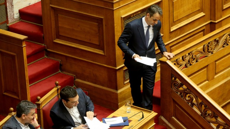 FILE PHOTO: Ο πρόεδρος της Νέας Δημοκρατίας Κυριάκος Μητσοτάκης (Δ) αποχωρεί από το βήμα μετά το τέλος της ομιλίας του στην ολομέλεια της Βουλής. Αριστερά ο κ. Αλέξης Τσίπρας.  ΑΠΕ-ΜΠΕ, Παντελής Σαίτας