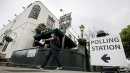 FILE PICTURE. A man walks past a pub used as a polling station to vote in the EU Referendum in London. EPA/HANNAH MCKAY