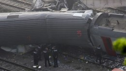 FILE PHOTO. Experts work on a train wreck. EPA/OLIVIER HOSLET