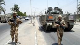 British soldiers patrol near Iraqi police Academy  in Bassra Iraq. EPA/HAIDER AL-ASADI