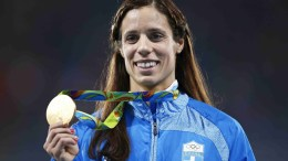 Ekaterini Stefanidi of Greece poses with her gold medal on the podium after winning the women's Pole Vault final of the Rio 2016 Olympic Games Athletics, Track and Field events at the Olympic Stadium in Rio de Janeiro, Brazil, 20 August 2016. EPA, YOAN VALAT