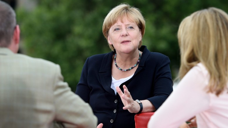German Chancellor Angela Merkel (C) is questioned during a TV interview by the ARD presenters Tina Hassel (R) and Thomas Baumann (L) at a gallery of Elisabeth Lueders House in Berlin, Germany, 28 August 2016. EPA, RAINER JENSEN