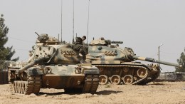 FILE PHOTO. A Turkish soldier on his tank in Syria.  EPA, SEDAT SUNA