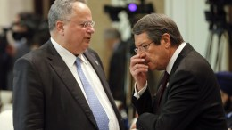 FILE PHOTO: Greek Foreign Minister Nikos Kotzias (L) talks to Cyprus' President Nicos Anastasiades before the opening session of the Asia-Europe Meeting (ASEM) summit in Ulan Bator, Mongolia. EPA, DAMIR SAGOLJ , POOL