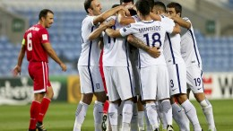 Players of Greece celebrate after the FIFA World Cup 2018 qualifying soccer match at Algarve stadium in Faro, southern Portugal, 06 September 2016. Greece won 4-1