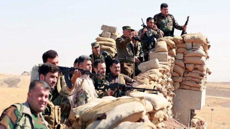 Iraqi Kurdish Peshmerga fighters take up positions to the front. EPA/AHMED JALIL