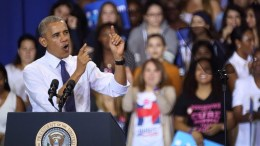 US President Barack Obama speaks during a rally to campaign for Democratic presidential candidate Hillary Clinton (not pictured) at Florida International University in Miami, Florida, USA, 03 November 2016. At a public event, President Obama laid out the high stakes of November's election for Florida families and urged voters to take advantage of in-person early voting. EPA, CRISTOBAL HERRERA