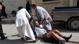 FILE PHOTO. People shift an injured man at the scene of a bomb blast.  EPA/JAMAL TARAQAI ATTENTION EDITORS: PICTURE CONTAINS GRAPHIC CONTENT
