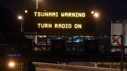 A motorway sign warning of a possible tsunami after an earthquake based around Cheviot in the South island hit the capital Wellington, New Zealand, early 14 November 2016. According to reports, a 7.8 magnitude earthqauke has hit New Zealand overnight, triggering a tsunami warning for the east coast of the country. EPA, ROSS SETFORD