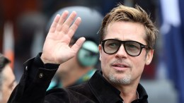 US actor Brad Pitt waves before he officially waves the start flag of Le Mans 24 Hours race in Le Mans, France, 18 June 2016. The race started at 15pm a day earlier and is scheduled to finish at 15pm on 19 June.  EPA/EDDY LEMAISTRE