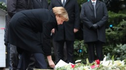 FILE PHOTO. The Chancellor of Germany, Angela Merkel (C) (CDU), lays flowers at the scene of an attack on a Christmas market in Berlin, Germany, 20 December 2016. She was accompanied by the Minister of the Interior Thomas de Maiziere (CDU) and Foreign Minister Frank-Walter Steinmeier (SPD). At least 12 people were killed and dozens injured when a truck on 19 December drove into the Christmas market at Breitscheidplatz in Berlin, in what authorities believe was a deliberate attack. EPA, MICHAEL KAPPELER