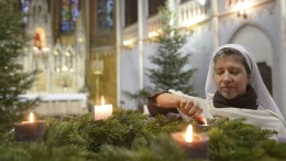 Sister Terezia of the Nyolc Boldogsag Kozosseg (Community of the Eight Bliss) lights the candles of an Advent wreath in the Church of Perpetual Adoration (Orokimadas-templom) in Budapest, Hungary, 24 December 2016. EPA/BEA KALLOS HUNGARY OUT