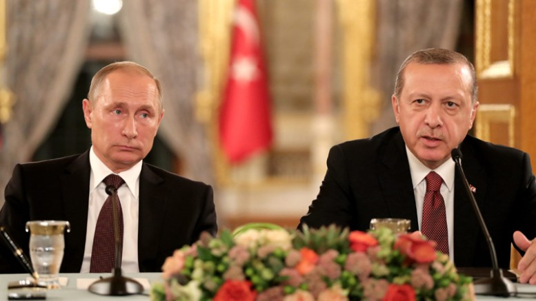 Russian President Vladimir Putin (L) and Turkey's President Recep Tayyip Erdogan (R) sit next to each other as they meet on the sidelines of the 23rd World Energy Congress, in Istanbul, Turkey, 10 October 2016.  EPA, TOLGA BOZOGLU