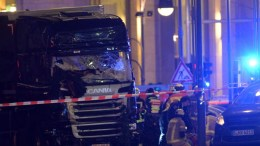 FILE PHOTO. Rescue workers at the scenes a truck crashed into a Christmas market, close to the Kaiser Wilhelm memorial church in Berlin, Germany. EPA/PAUL ZINKEN