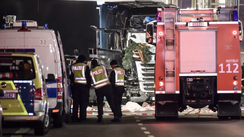 The truck that crashed into a Christmas market, close to the Kaiser Wilhelm memorial church in Berlin, Germany, 19 December 2016. According to the police, several people are reported killed and many injured in what police suspect was a deliberate attack. EPA, Clemens Bilan