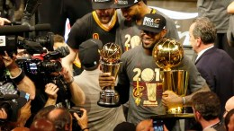 Cleveland Cavaliers forward LeBron James poses with the MVP trophy and the NBA Championship trophy after defeating the Golden State Warriors in NBA Finals game seven at Oracle Arena in Oakland, California, USA, 19 June 2016. The Cavaliers defeated the Warriors to win the NBA Finals Champions.  EPA/JOHN G. MABANGLO CORBIS OUT