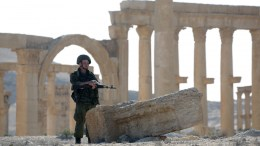 FILE PHOTO. A Russian soldier patrols the ruins of the ancient city of Palmyra, Syria. EPA/SERGEI CHIRIKOV