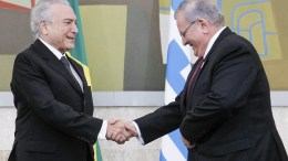A handout photo made available by the Presidency of Brazil on 30 December 2016 shows Brazilian President Michel Temer (L) shaking hands with Greece's ambassador to Brazil Kyriakos Amiridis (R), during a ceremony in Brasilia, Brazil, 25 May 2016. Amiridis was last seen on Monday, 26 December in the Nova Iguacu neighborhood while en route to Rio de Janiero, and was reported missing by his wife on 28 December 2016, according to the Rio State Police. On 29 December, a burned-out rental car that was registered to Amirdis was found in the Nova Iguacu neighborhood. Police officials stated that a body was found in the trunk of the car, and forensic experts are working to establish the identity of the remains. EPA/BETO BARATA PRESIDENCY OF BRAZIL / HANDOUT HANDOUT EDITORIAL USE ONLY/NO SALES