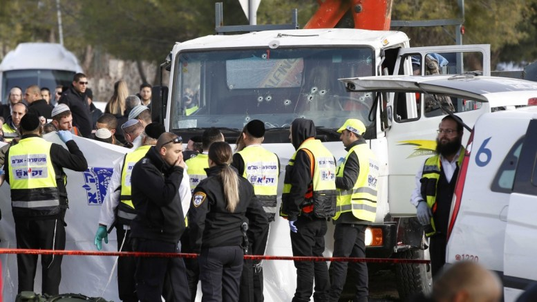 Members of a ZAKA voluntary community emergency response teams and Israeli police work in front of a truck after a ramming attack on the Armon Hanatziv promenade in Jerusalem, Israel, 08 January 2017. Reportedly four Israeli soldiers were killed and another 15 wounded in the attack carried out by a Palestinian who had been released from Israeli jail. The driver of the truck, reported by local media to be an Arab Israeli from East Jerusalem, was shot and killed by security forces, media reports said. EPA, ABIR SULTAN