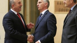 Turkish Foreign Minister Mevlut Cavusoglu, (L), shakes hand with Swiss Foreign minister Didier Burkhalter, (C), next to United Nations Director-General Michael Moeller, (R), during the Conference on Cyprus at the European headquarters of the United Nations in Geneva, Switzerland, 12 January 2017. EPA/PIERRE ALBOUY / POOL