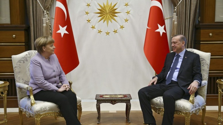FILE PHOTO: A handout photo made available by the German Federal Government Press OFfice (BPA) shows German Chancellor Angela Merkel (L) and Turkish President Recep Tayyip Erdogan (R). EPA, Guido Bergmann