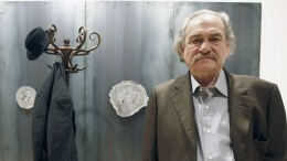 Greek artist Jannis Kounellis poses for photographers next to one of his works at the exhibition that opens its doors to public 30 October 2009 in Santander, Cantabria, Northern Spain. The artist continues reflecting about the tragedy of existence.  EPA/ESTEBAN COBO