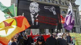 A banner reads; 'Kill Erdogan with his own weapons', as protesters march during a demonstration against the Turkish President Recep Tayyip Erdogan, in Bern, Switzerland. EPA, PETER KLAUNZER