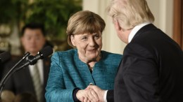 US President Donald J. Trump (R) and German Chancellor Angela Merkel (L) shake hands after a joint news conference in the East Room of the White House in Washington, DC, USA, 17 March 2017. EPA, CLEMENS BILAN