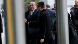 Turkish Minister of Foreign Affairs Mevlut Cavusoglu (L) arrives at Ataturk Airport in Istanbul, Turkey, 11 March 2017. The Turkish Minister of Foreign Affairs Mevlut Cavusoglu had planned a speech in the Turkish Consul's residence in Hillegersberg, Rotterdam, but his flight to the Netherlands was cancelled. EPA, TOLGA BOZOGLU