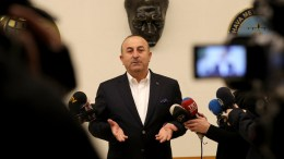 Turkish Minister of Foreign Affairs Mevlut Cavusoglu speaks to members of the media at Ataturk Airport in Istanbul, Turkey. EPA, TOLGA BOZOGLU