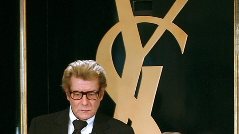 French fashion designer Yves Saint-Laurent (L), flanked by YSL trademark general manager Pierre Berge, is to give a press conference 07 January 2002 in Paris. Yves Saint-Laurent announced his retirement and the closure of his haute couture business.   EPA PHOTO AFP/ERIC FEFERBERG