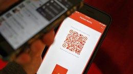 A photo illustration of a WeChat user scanning a QR code to retrieve a digital red envelope on the WeChat app on a mobile phone during the Chinese New Year period in Beijing, China, 30 January 2017. Digital red envelope, a service provided by the mobile phone app WeChat to represent 'hongbao' envelopes filled with money that Chinese traditionally gift each other for good luck during the Chinese Lunar New Year, have gained popularity. According to reports, 32 billion packets have been sent and received by 516 million people over the six-day celebration of the Lunar New Year in 2016 through the app, ten times more than in 2015. Around 100 billion envelopes are expected to be sent during the celebration period of the year 2017, according to forecasts.  EPA/STR