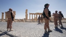 FILE PHOTO. Russian soldiers patrol the ruins of the ancient city of Palmyra in Syria. EPA/SERGEI CHIRIKOV