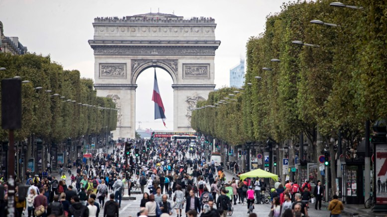 Pedestrians take to the street on the famous Champs-Elysee, free of its usual traffic as part of Paris' 'No Car Day', with traffic banned in sections of the city, and reduced to public transport vehicles only in other zones, in Paris, France, 25 September 2016. Paris mayor Anne Hidalgo had launched the first 'no car day' in september 2015, and plans to extend the initiative to every first Sunday of the month year-round.  EPA/IAN LANGSDON  EPA/IAN LANGSDON
