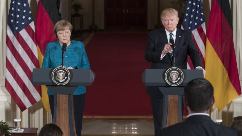 US President Donald J. Trump (R) and Chancellor of Germany Angela Merkel (L) listen to a question from a member of the news media during a joint press conference in the East Room of the White House in Washington, DC, USA, 17 March 2017. Merkel and Trump meet at the White House for their first face-to-face meeting with an agenda of discussing transatlantic trade and security issues among two of the world's leading economies. EPA/MICHAEL REYNOLDS