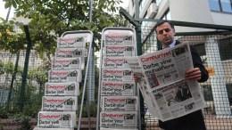 FILE PHOTO. A Turkish man reads Cumhuriyet in front the newspapers headquarter in Istanbul, Turkey. EPA, SEDAT SUNA