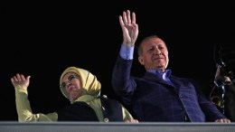 Turkish President Recep Tayyip Erdogan (R) and with his wife Emine (L) wave to supporters during a rally after he declared a victory of the 'Yes' vote in the constitutional referendum, in Istanbul. EPA, TOLGA BOZOGLU
