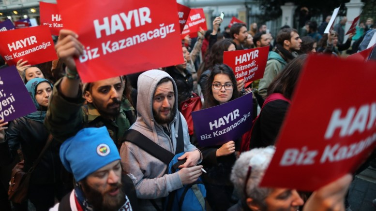File Photo: Protesters shout slogans and hold placards reading 'NO we will win' during a rally against the referendum results in Istanbul, Turkey. EPA, TOLGA BOZOGLU