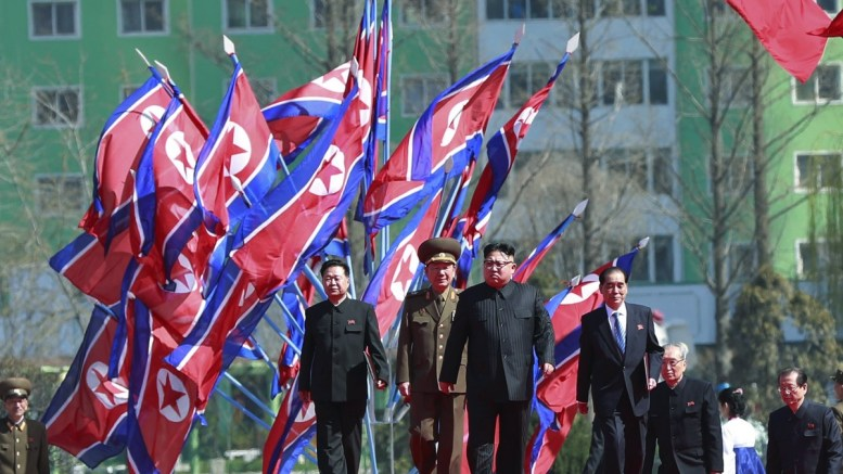 FILE PHOTO. North Korean leader Kim Jong-un (C) arrives for an opening ceremony of a new residential housing project on Ryo Myong street in Pyongyang, North Korea. EPA, HOW HWEE YOUNG