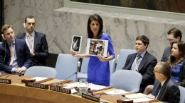 Nikki Haley, the United States' Ambassador to the United Nations, holds up pictures of victims of a chemical attack in Syria during an emergency meeting of the United Nations Security Council at United Nations headquarters in New York, New York, USA, 05 April 2017. Britain, France and the United States have called for a resolution condemning the attack, in which 72 people were reportedly killed, including 20 children, but Russia has said it does not support such a resolution. EPA, JUSTIN LANE