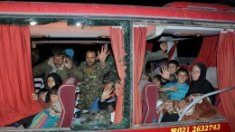 Syrians families wave from window of bus as they are evacuated from two besieged towns of Kefraya and al-Foua'a arrived at Al Ramousa area in Aleppo , Syria 15 April 2017. EPA, ABDO HAJJ AHMAD