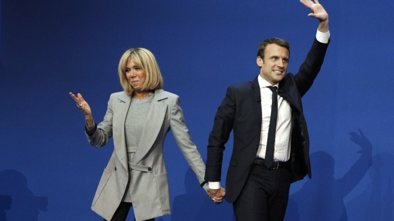French presidential election candidate for the 'En Marche!' (Onwards!) political movement, Emmanuel Macron (R) celebrates with his wife Brigitte Trogneux (L) after the first round of the French presidential elections in Paris, France. EPA, YOAN VALAT